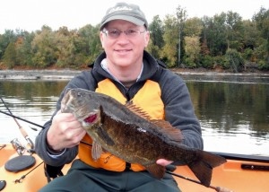 One of my Guided Kayak Fishing Class students with a nice smallmouth bass caught on a Winco's Baby Predator Craw.